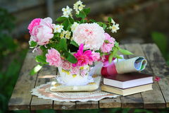 Beauty spring bouquet and book's Stock Photo