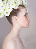 Beauty spring girl with chamomile wreath Royalty Free Stock Images