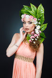 Beauty Spring girl with flowers hair. Beautiful model woman with flowers on her head. The Nature Of Hairstyle. Summer Stock Images
