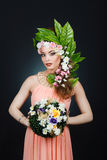 Beauty Spring girl with flowers hair. Beautiful model woman with flowers on her head. The Nature Of Hairstyle. Summer. Beauty Spring Girl with Flowers Hair Style Royalty Free Stock Photography