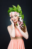 Beauty Spring girl with flowers hair. Beautiful model woman with flowers on her head. The Nature Of Hairstyle. Summer Royalty Free Stock Photos