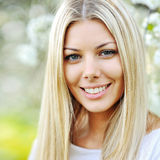 Beauty spring girl portrait over blooming tree stock image