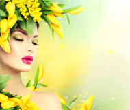 Beauty spring model girl with flowers hair style stock photography
