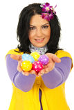 Beauty spring woman giving Easter egss Royalty Free Stock Photos