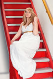 Beauty on a stairway. Royalty Free Stock Photography