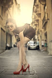 Beauty on the street. In red shoes Stock Photography
