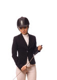 Beauty strict jockey with thin switch Royalty Free Stock Photos