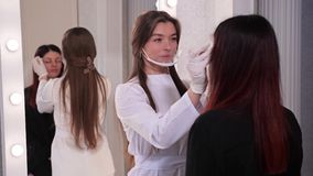 Beauty Studio. Beautician, draws the eyebrows of a girl before the procedure of permanent makeup. 4K Slow Mo. Beauty Studio. Beautician, draws the eyebrows of a stock video