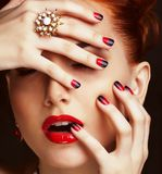 Beauty stylish redhead woman with hairstyle wearing jewelry royalty free stock photography