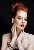 Beauty stylish redhead woman with hairstyle and manicure wearing Stock Images