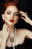 Beauty stylish redhead woman with hairstyle and manicure wearing jewelry pearl close up royalty free stock photography