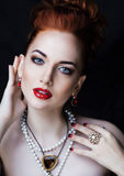 Beauty stylish redhead woman with hairstyle and Royalty Free Stock Photography