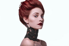 Beauty stylish redhead woman with hairstyle and wearing necklace jewelry. In studio royalty free stock images