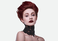 Beauty stylish redhead woman with hairstyle and wearing necklace jewelry Royalty Free Stock Images