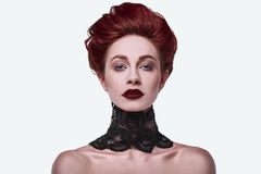 Beauty stylish redhead woman with hairstyle and wearing necklace jewelry. In studio royalty free stock photos