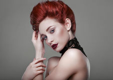 Beauty stylish redhead woman with necklace jewelry in studio Stock Image