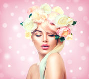 Beauty summer model girl with colorful flowers wreath. Flowers hair style Royalty Free Stock Photo
