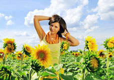 Beauty and sunflowers Royalty Free Stock Photos