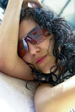Beauty with sunglasses. Beautiful black hair model is wearing expensive sunglasses Stock Photos