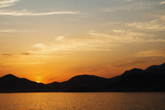 Beauty sunset at the Adriatic sea in Montenegro. Beauty nature sunset at sea mountain background stock photos