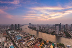 Beauty of sunset with Bangkok city and river curve view Royalty Free Stock Photo
