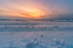 Beauty of sunset over Baikal freezing water lake. Winter season natural landscape Royalty Free Stock Photography