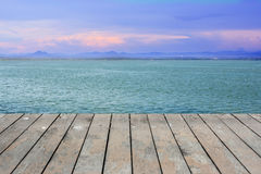Beauty sunset over lake on wooden floor. Royalty Free Stock Image