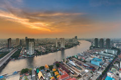 Beauty sunset sky over Bangkok city river curved Royalty Free Stock Images