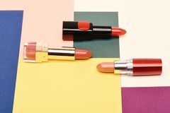 Beauty supplies, lipstick, copy space. Three red, scarlet lipsticks stock image