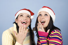 Beauty surprised two women looking up Stock Photography