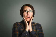 Beauty surprised woman on grey background Stock Photo