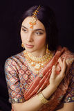 Beauty sweet indian girl in sari smiling Stock Images