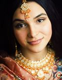 Beauty sweet real indian girl in sari smiling on black background, jewelry shining. Closeup royalty free stock photos