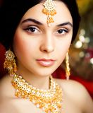 Beauty sweet real indian girl in sari smiling on black background, jewelry shining. Closeup stock photo
