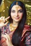 Beauty sweet real indian girl in sari smiling cheerful, jewelry shining, lifestyle people concept. Closeup stock photos