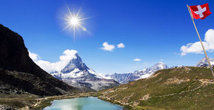 Beauty Swiss, panorama of mountain and lake with sunlight on blu Royalty Free Stock Photos