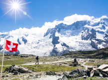 Beauty Swiss, trekking on mountain  with sunlight on blue sky -. Switzerland Royalty Free Stock Image