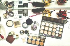 Beauty table with various cosmetics for make-up. Top view. white background royalty free stock photo