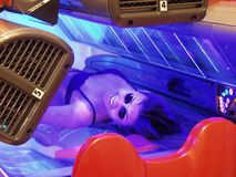 Beauty in tanning bed. Beautiful woman in protective goggles enjoying her time in tanning bed Royalty Free Stock Photo