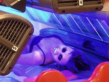 Beauty in tanning bed. Beautiful woman in protective goggles enjoying her time in tanning bed Royalty Free Stock Images