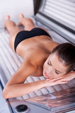 Beauty on tanning bed. Stock Image