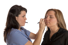 Beauty technician applying makeup on client Royalty Free Stock Photo
