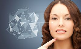 Beautiful woman with low poly shape projection Stock Photo