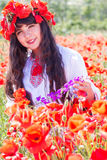 Beauty teen girl in field of red poppies Stock Images