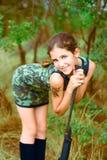 Beauty teen girl with gun Stock Photography