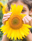 Beauty teen girl with sunflower Stock Photos