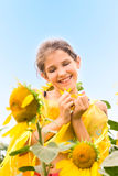 Beauty teen girl and sunflowers Royalty Free Stock Photo