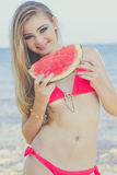 Beauty teen model girl eating watermelon Stock Photo