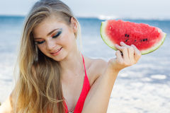 Beauty teenage model girl eating watermelon Stock Photos