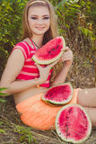 Beauty teenage model girl eating watermelon Stock Image